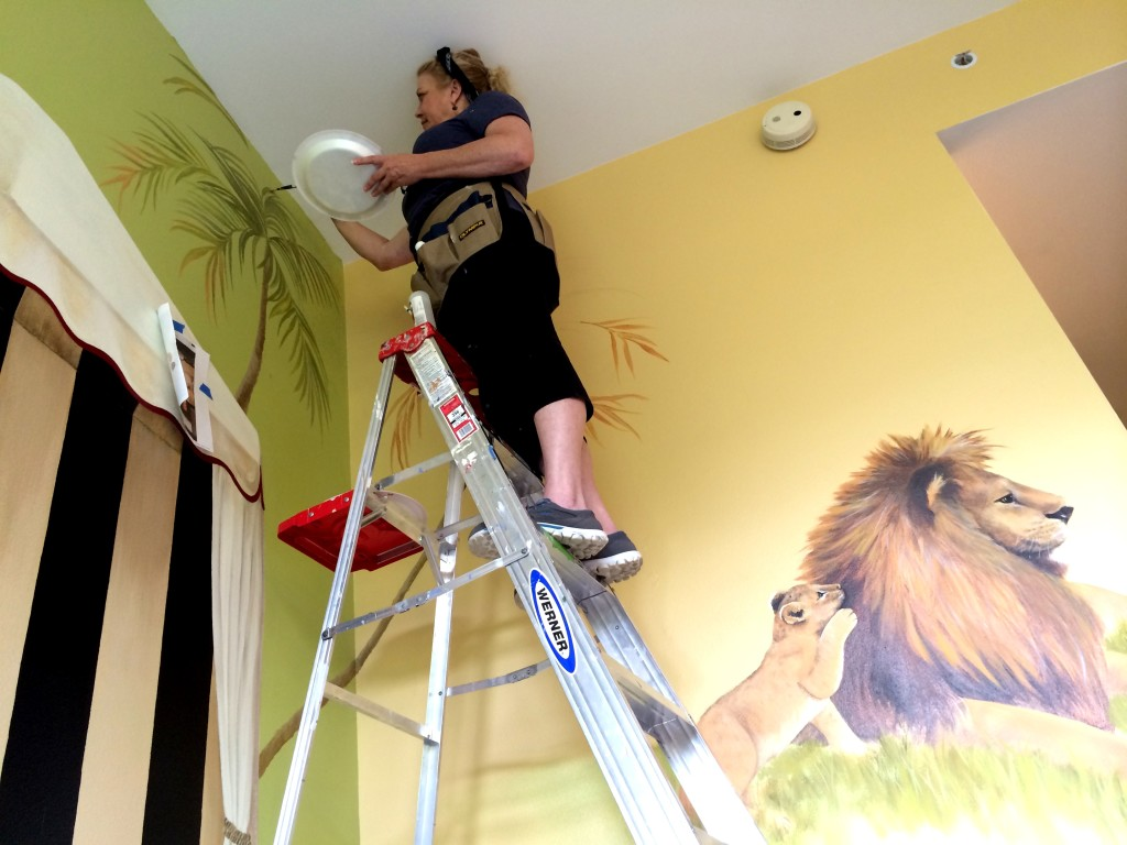 Karen painting a palm tree
