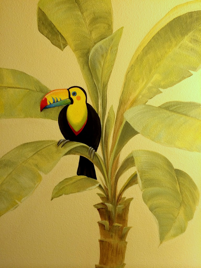 I painted a toucan in a tree in the bathroom vanity area